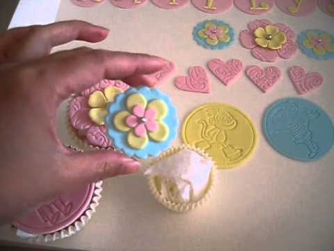 Dora & pretty cupcake toppers (how to videos on my channel for the letter & flowers)