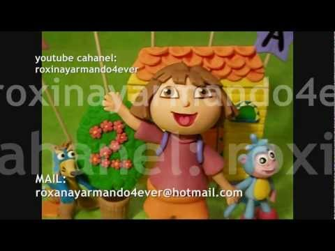Dora, boots and swiper cake toppers made of edible gum paste.in chicago il