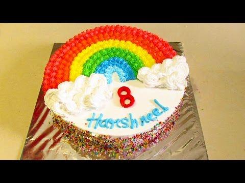 Rainbow cake recipe - how to make eggless rainbow cake with fresh cream no fondant in hindi